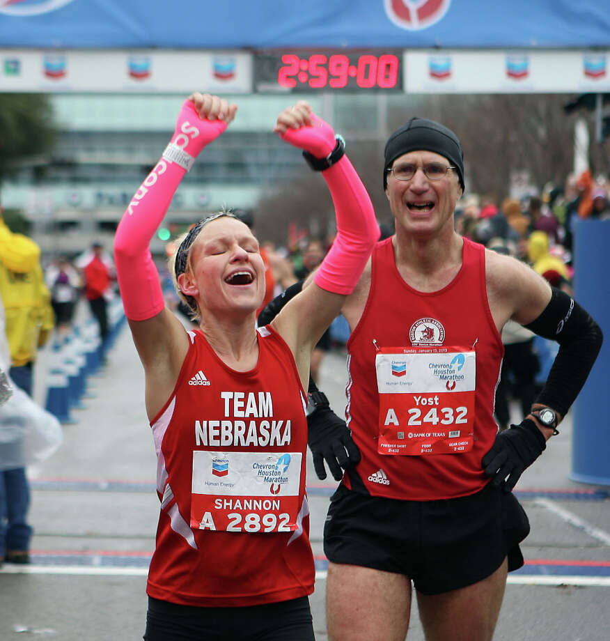 Shannon Suing left, and Mark Yost react after finishing the Chevron Houston Marathon. Photo: James Nielsen, Chronicle / © Houston Chronicle 2013