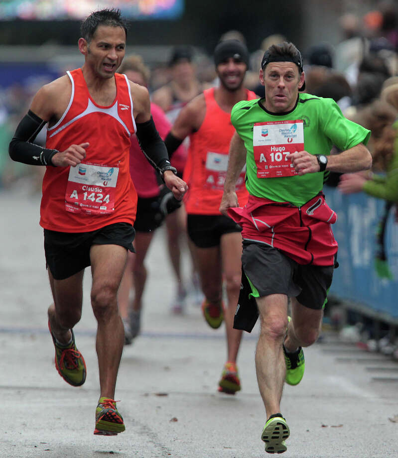 Claudio Rodriguez left, and Hugh Leidlein right, near the finish line. Photo: James Nielsen, Chronicle / © Houston Chronicle 2013