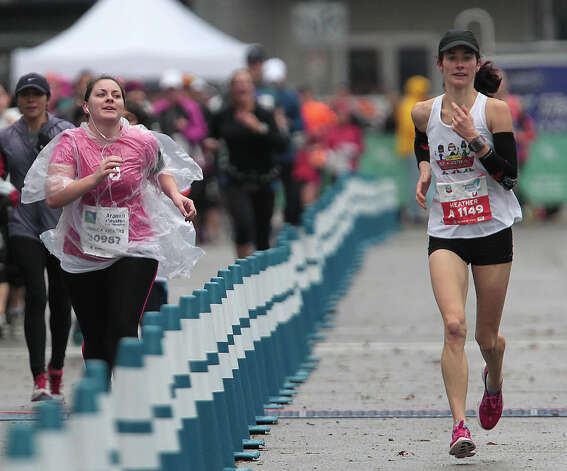 Monica Vickers, left, runs in the Aramco Half Marathon as Heather Hamilton, right, runs in the the Chevron Houston Marathon. Photo: James Nielsen, Chronicle / © Houston Chronicle 2013