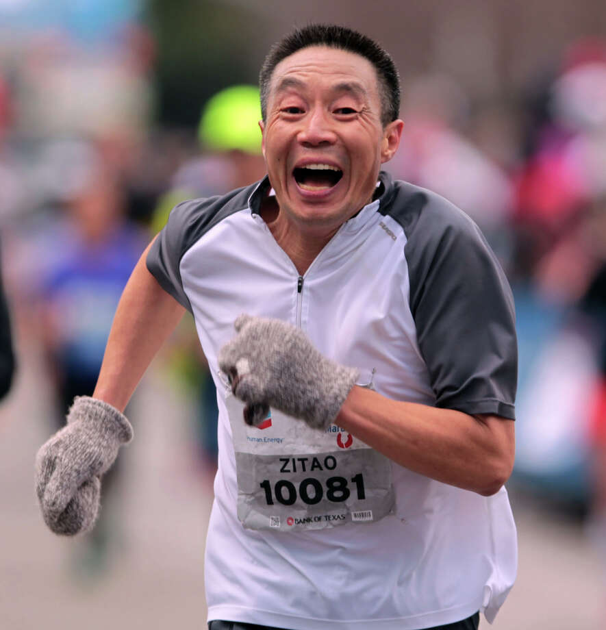 Zitao Xu nears the finish line. Photo: James Nielsen, Chronicle / © Houston Chronicle 2013