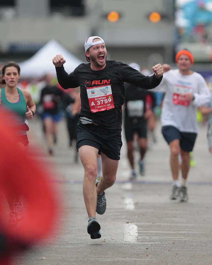 Kristian Jonsson nears the finish line. Photo: James Nielsen, Chronicle / © Houston Chronicle 2013