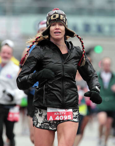 Kristy Lancaster nears the finish line. Photo: James Nielsen, Chronicle / © Houston Chronicle 2013