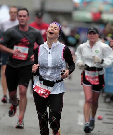 Irma Hammond nears the finish line. Photo: James Nielsen, Chronicle / © Houston Chronicle 2013