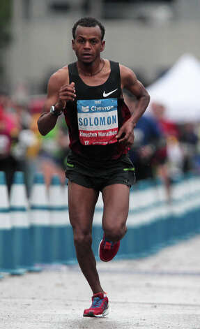 Solomon Molla runs on his way to a third place in the men's division of the Chevron Houston Marathon. Photo: James Nielsen, Chronicle / © Houston Chronicle 2013