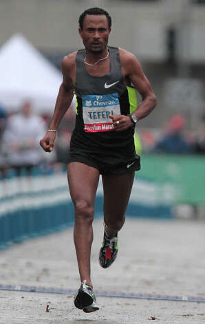 Teferi Balcha runs on his way to a second place in the men's division of the Chevron Houston Marathon. Photo: James Nielsen, Chronicle / © Houston Chronicle 2013