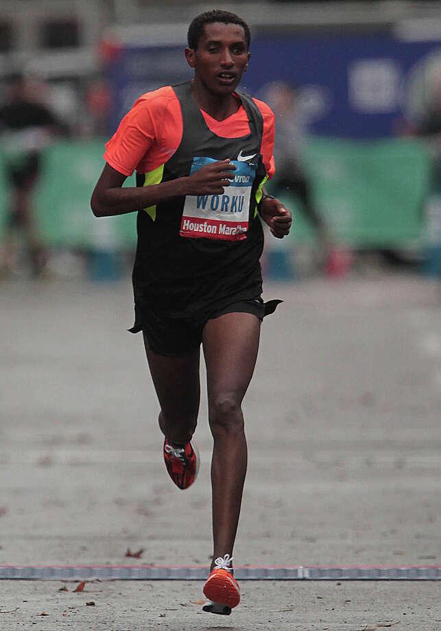 Bazu Worku runs to the finish line to win the Chevron Houston Marathon. Photo: James Nielsen, Chronicle / © Houston Chronicle 2013