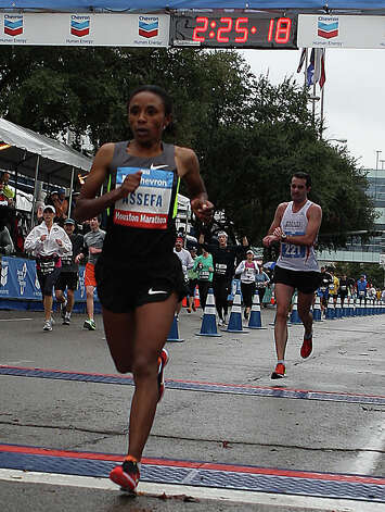 Meskerem Assefa crosses the finish line for a third place finish in the women's division of the Chevron Houston Marathon. Photo: James Nielsen, Chronicle / © Houston Chronicle 2013
