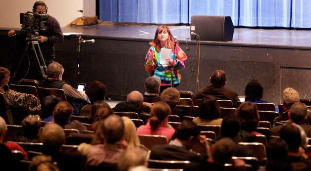 Kristen Kinsey, of Newtown, speaks during a community meeting at Newtown High School on the future of Sandy Hook Elementary School, the site of the second-deadliest school shooting in U.S. history January 13, 2013. REUTERS/ Michelle McLoughlin/Pool (UNITED STATES) Photo: REUTERS/ Michelle McLoughlin/Poo,  REUTERS/ Michelle McLoughlin/Po / The News-Times