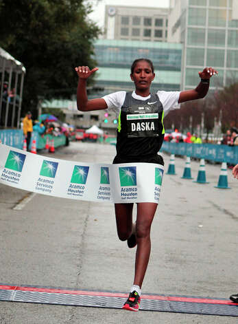 Mamitu Daska, of Ethiopa, crosses the finish line to win the women's division of the Half Marathon. Photo: James Nielsen, Associated Press / Houston Chronicle