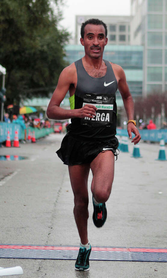 Deriba Merga, of Ethiopia, runs on his way to a second-place finish in the Half Marathon. Photo: James Nielsen, Associated Press / Houston Chronicle