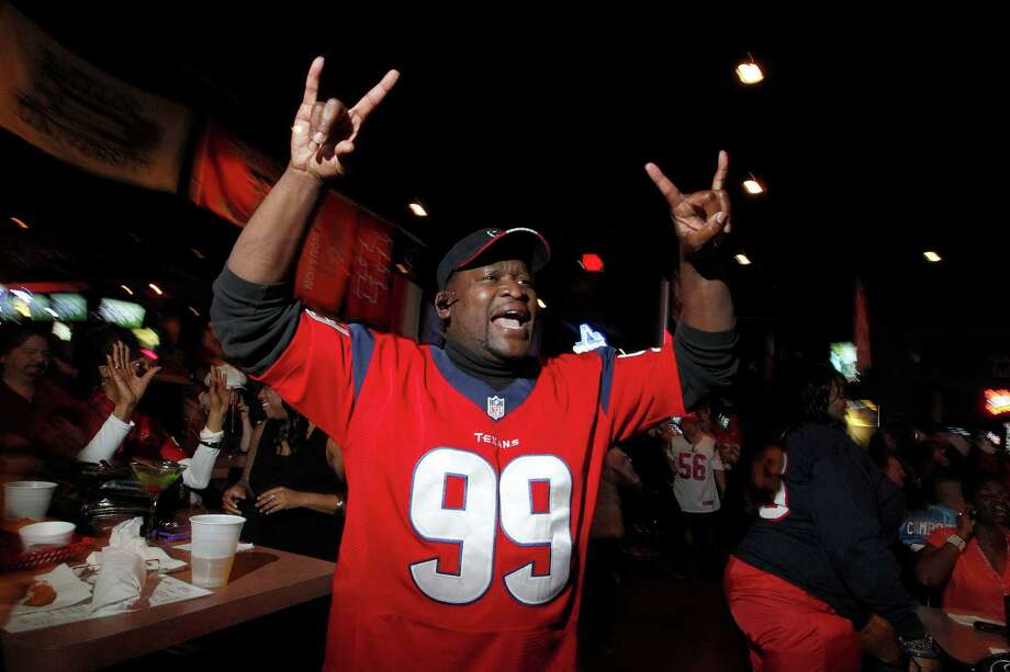 Kevin Sanders celebrates at Houston Texans first down while watching the Texans play the New England Patriots at SRO Sports Bar and Cafe Sunday, Jan. 13, 2013, in Houston. Photo: Johnny Hanson, Houston Chronicle / © 2013  Houston Chronicle