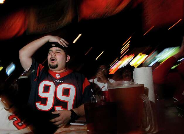 Jose Murillo reacts as the Patriots score while watching the Texans play the New England Patriots at SRO Sports Bar and Cafe Sunday, Jan. 13, 2013, in Houston. Photo: Johnny Hanson, Houston Chronicle / © 2013  Houston Chronicle