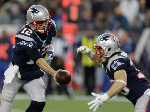 New England Patriots quarterback Tom Brady (12) hands off to running back Danny Woodhead during the first half of an AFC divisional playoff NFL football game against the Houston Texans in Foxborough, Mass., Sunday, Jan. 13, 2013. (AP Photo/Charles Krupa) Photo: Charles Krupa, Associated Press / AP