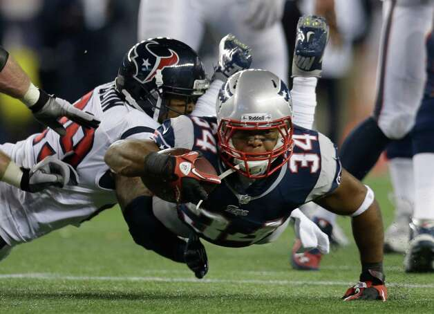New England Patriots running back Shane Vereen (34) is tackled by Houston Texans strong safety Glover Quin during the first half of an AFC divisional playoff NFL football game in Foxborough, Mass., Sunday, Jan. 13, 2013. (AP Photo/Elise Amendola) Photo: Elise Amendola, Associated Press / AP