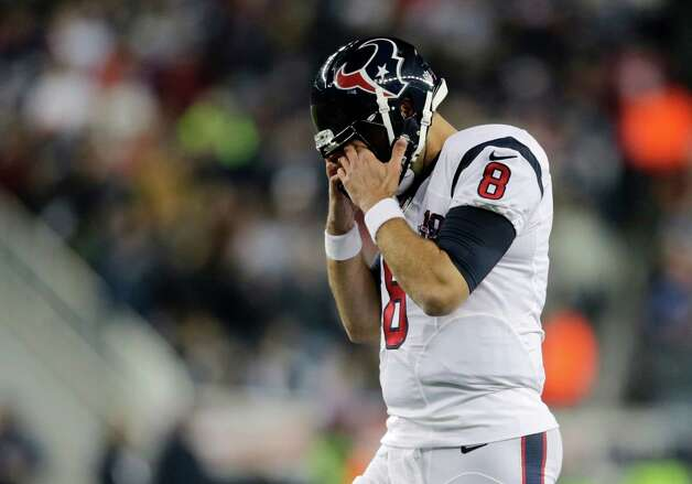 Houston Texans quarterback Matt Schaub rubs his eyes as he walks off the field during the first half of an AFC divisional playoff NFL football game against the New England Patriots in Foxborough, Mass., Sunday, Jan. 13, 2013. (AP Photo/Charles Krupa) Photo: Charles Krupa, Associated Press / AP