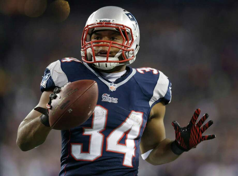 New England Patriots running back Shane Vereen holds up the ball after scoring on an eight-yard touchdown pass during the first half of an AFC divisional playoff NFL football game against the Houston Texans in Foxborough, Mass., Sunday, Jan. 13, 2013. (AP Photo/Elise Amendola) Photo: Elise Amendola, Associated Press / AP