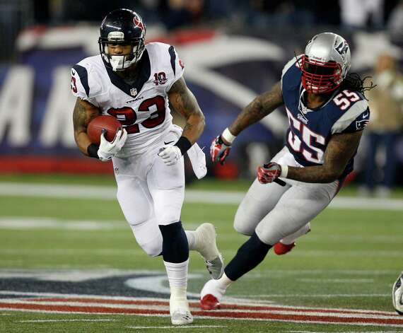Houston Texans running back Arian Foster (23) is chased by New England Patriots middle linebacker Brandon Spikes during the first half of an AFC divisional playoff NFL football game in Foxborough, Mass., Sunday, Jan. 13, 2013. (AP Photo/Stephan Savoia) Photo: Stephan Savoia, Associated Press / AP