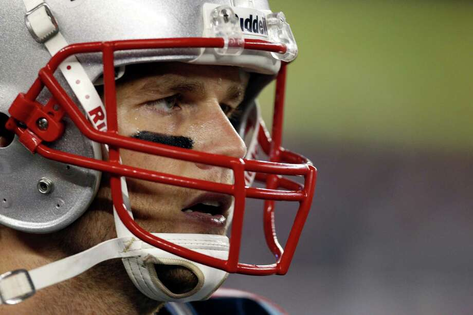 New England Patriots quarterback Tom Brady during the first half of an AFC divisional playoff NFL football game against the Houston Texans in Foxborough, Mass., Sunday, Jan. 13, 2013. (AP Photo/Stephan Savoia) Photo: Stephan Savoia, Associated Press / AP
