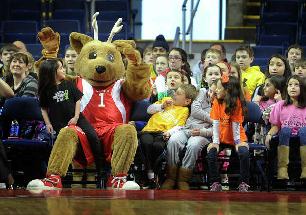 The Fairfield University mascot sits courtside with Newtown students for Fairfield's men's basketball matchup with Niagara at the Webster Bank Arena in Bridgeport on Sunday, January 13, 2013. Photo: Brian A. Pounds