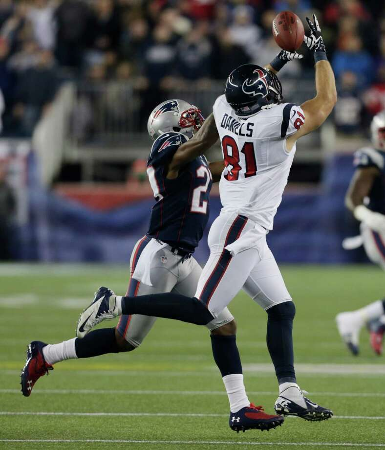 Houston Texans tight end Owen Daniels (81) cannot hold on to a pass while being defended by New England Patriots strong safety Tavon Wilson during the first half of an AFC divisional playoff NFL football game in Foxborough, Mass., Sunday, Jan. 13, 2013. (AP Photo/Charles Krupa) Photo: Charles Krupa, Associated Press / AP
