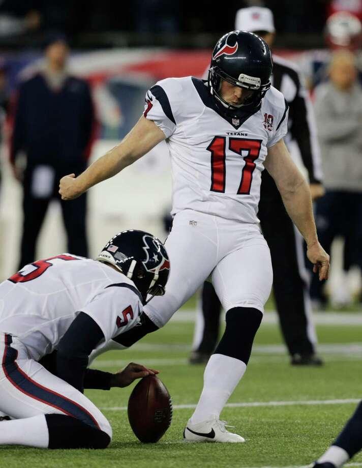 Houston Texans punter Donnie Jones, left holds as Shayne Graham (17) kicks a 27-yard field goal during the first half of an AFC divisional playoff NFL football game against the New England Patriots in Foxborough, Mass., Sunday, Jan. 13, 2013. (AP Photo/Charles Krupa) Photo: Charles Krupa, Associated Press / AP