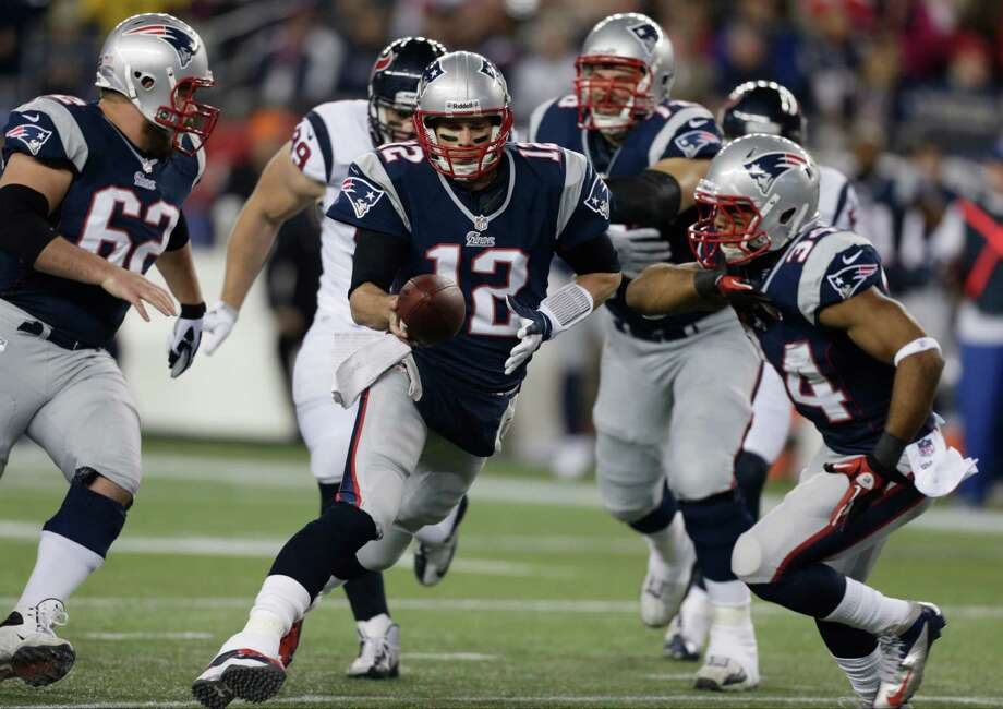 New England Patriots quarterback Tom Brady (12) hands off to Shane Vereen during the first half of an AFC divisional playoff NFL football game against the Houston Texans in Foxborough, Mass., Sunday, Jan. 13, 2013. (AP Photo/Charles Krupa) Photo: Charles Krupa, Associated Press / AP