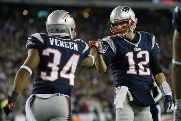 New England Patriots running back Shane Vereen, left, is congratulated by quarterback Tom Brady after Vareen's eight-yard touchdown pass reception from Brady during the first half of an AFC divisional playoff NFL football game in Foxborough, Mass., Sunday, Jan. 13, 2013. (AP Photo/Elise Amendola) Photo: Elise Amendola, Associated Press / AP