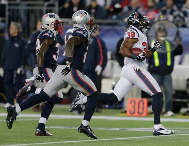 Houston Texans free safety Danieal Manning, right, is chased by New England Patriots free safety Devin McCourty, left, and Kyle Arrington on a 94-yard kickoff return during the first half of an AFC divisional playoff NFL football game in Foxborough, Mass., Sunday, Jan. 13, 2013. (AP Photo/Charles Krupa) Photo: Charles Krupa, Associated Press / AP
