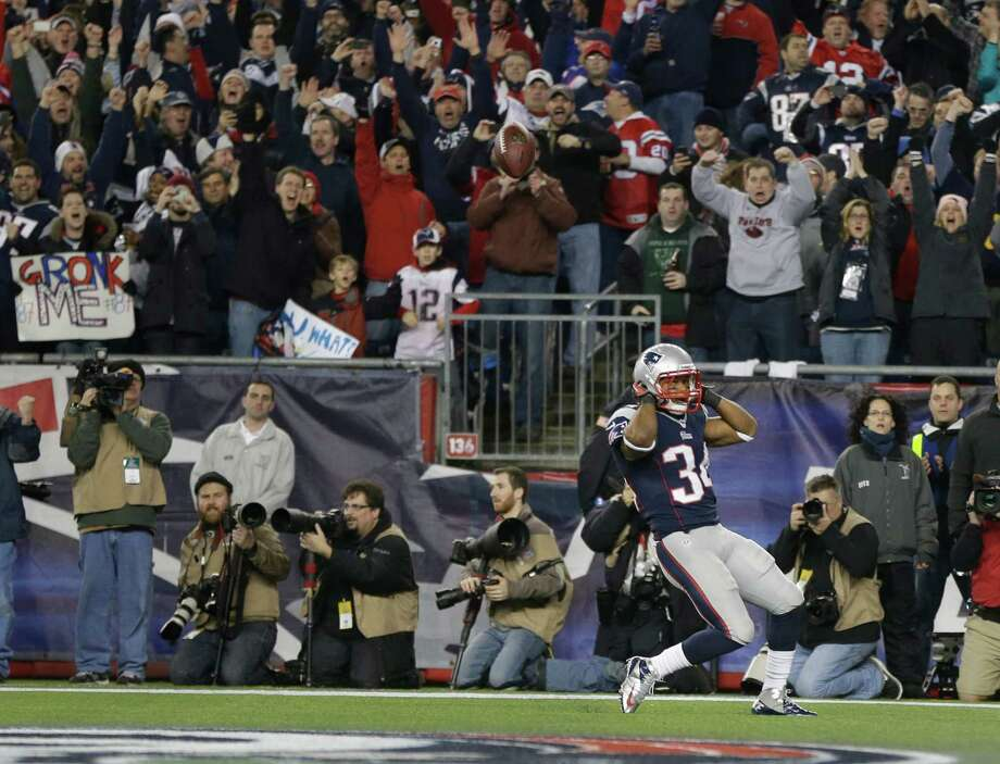 New England Patriots running back Shane Vereen celebrates his one-yard touchdown run during the first half of an AFC divisional playoff NFL football game against the Houston Texans in Foxborough, Mass., Sunday, Jan. 13, 2013. (AP Photo/Elise Amendola) Photo: Elise Amendola, Associated Press / AP