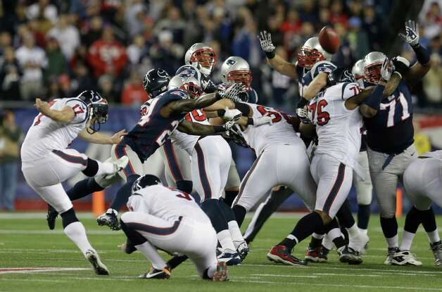 Houston Texans kicker Shayne Graham, left, kicks a 55-yard field goal during the first half of an AFC divisional playoff NFL football game against the New England Patriots in Foxborough, Mass., Sunday, Jan. 13, 2013. (AP Photo/Elise Amendola) Photo: Elise Amendola, Associated Press / AP