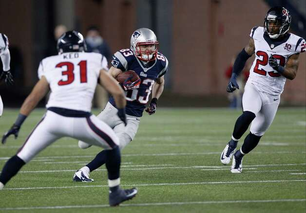 New England Patriots wide receiver Wes Welker (83) tries to get past Houston Texans defensive back Shiloh Keo (31) and Glover Quin during the first half of an AFC divisional playoff NFL football game in Foxborough, Mass., Sunday, Jan. 13, 2013. (AP Photo/Stephan Savoia) Photo: Stephan Savoia, Associated Press / AP