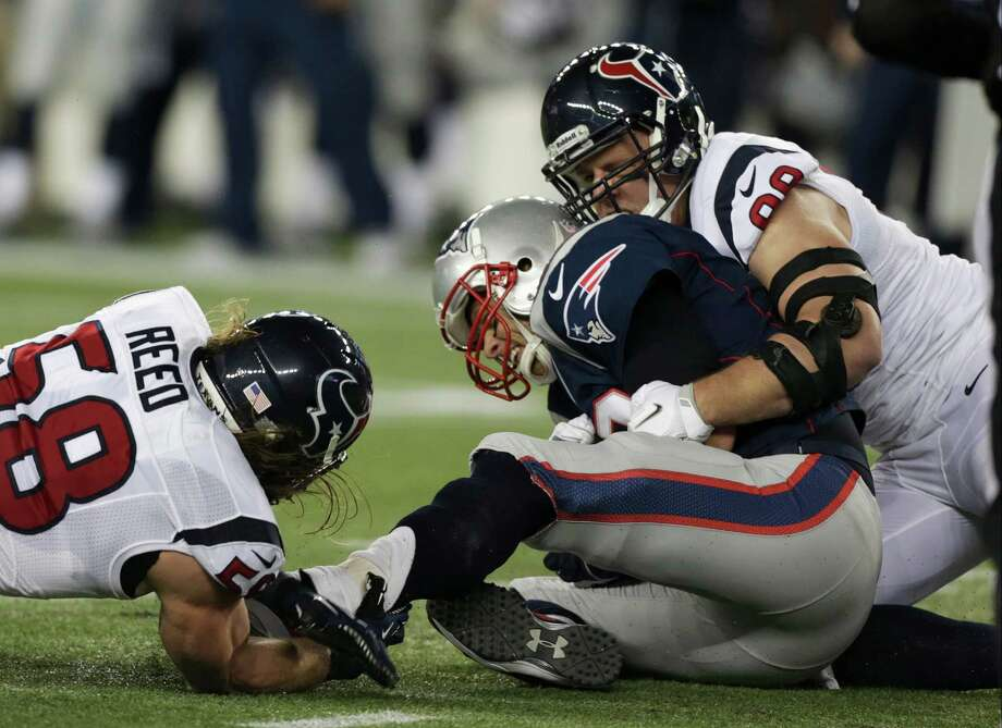 Houston Texans defensive end J.J. Watt (99) and Brooks Reed sack New England Patriots quarterback Tom Brady during the first half of an AFC divisional playoff NFL football game in Foxborough, Mass., Sunday, Jan. 13, 2013. (AP Photo/Charles Krupa) Photo: Charles Krupa, Associated Press / AP