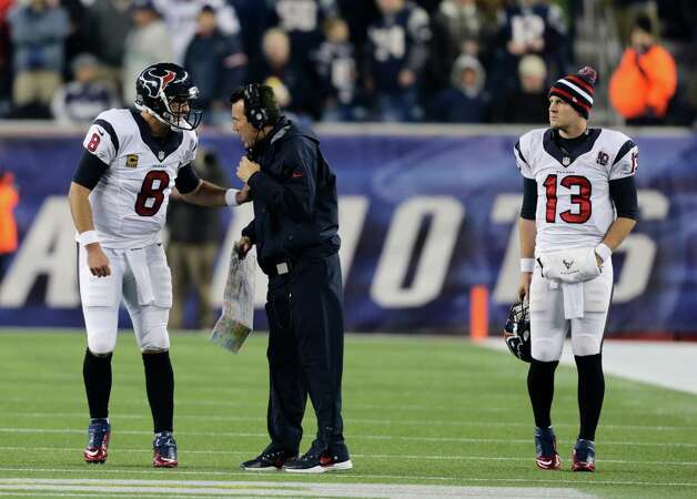 Houston Texans back up quarterback T.J. Yates, right, listens while Matt Schaub talks to head coach Gary Kubiak during the first half of an AFC divisional playoff NFL football game against the New England Patriots in Foxborough, Mass., Sunday, Jan. 13, 2013. (AP Photo/Charles Krupa) Photo: Charles Krupa, Associated Press / AP