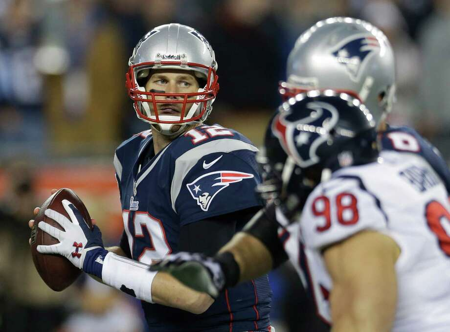 New England Patriots quarterback Tom Brady  looks to pass against the defense of Houston Texans linebacker Connor Barwin (98) during the first half of an AFC divisional playoff NFL football game in Foxborough, Mass., Sunday, Jan. 13, 2013. (AP Photo/Elise Amendola) Photo: Elise Amendola, Associated Press / AP