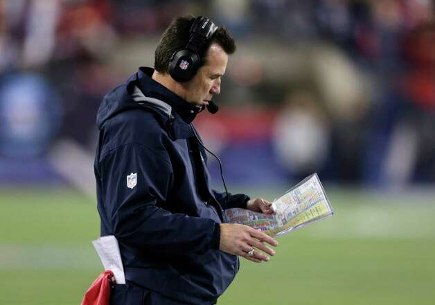 Houston Texans head coach Gary Kubiak looks at his play card during the first half of an AFC divisional playoff NFL football game against the New England Patriots in Foxborough, Mass., Sunday, Jan. 13, 2013. (AP Photo/Charles Krupa) Photo: Charles Krupa, Associated Press / AP