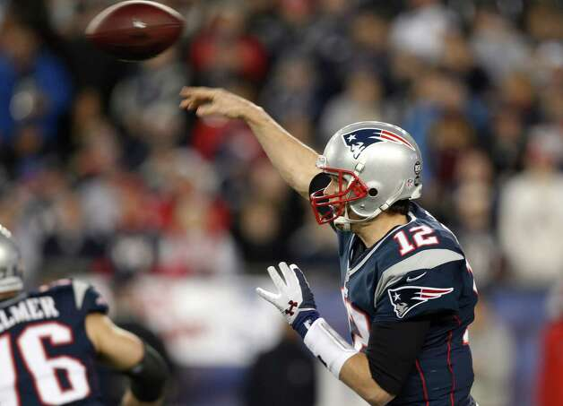 New England Patriots quarterback Tom Brady passes during the first half of an AFC divisional playoff NFL football game against the Houston Texans in Foxborough, Mass., Sunday, Jan. 13, 2013. (AP Photo/Stephan Savoia) Photo: Stephan Savoia, Associated Press / AP