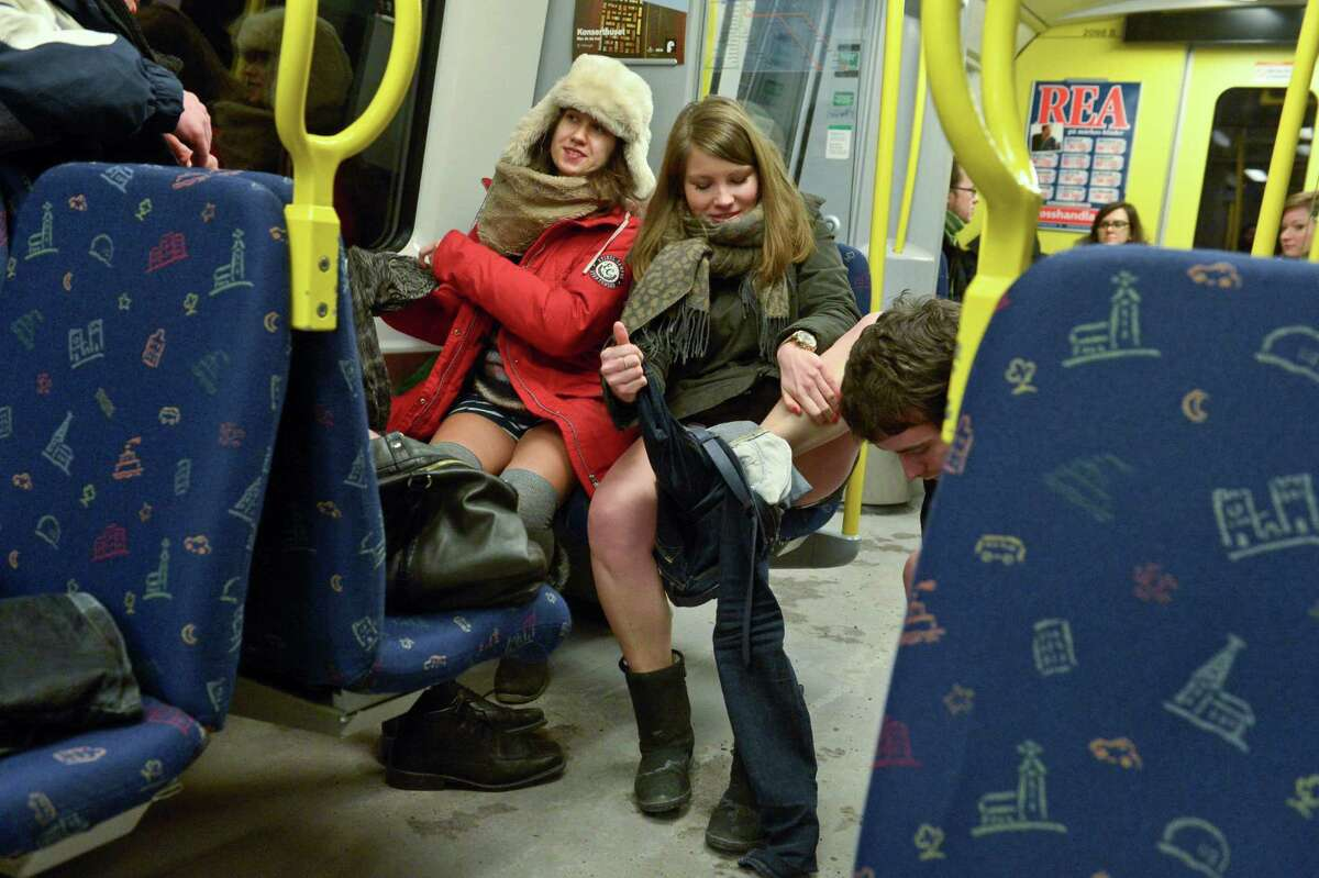Participants shed their clothes to take part in the annual 'No Pants Subway Ride' in Stockholm on Sunday. The yearly prank, organized by New York City based prank collective