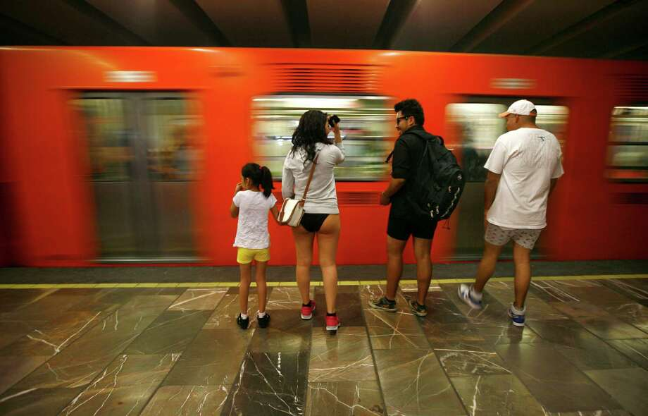 "Participants in the annual ""No Pants Subway Ride"" wait to get a train at a subway station in Mexico City on Sunday. Photo: AP"