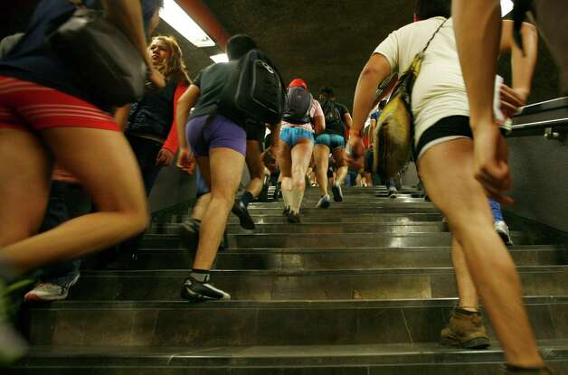 "Participants in the annual ""No Pants Subway Ride"" transfer to another train at a subway station in Mexico City, Sunday. Photo: AP"
