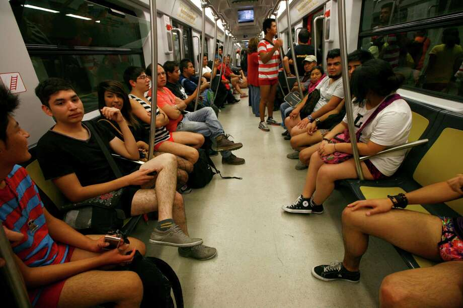 "Participants in the annual ""No Pants Subway Ride"" ride a train in Mexico City, Sunday. Photo: AP"