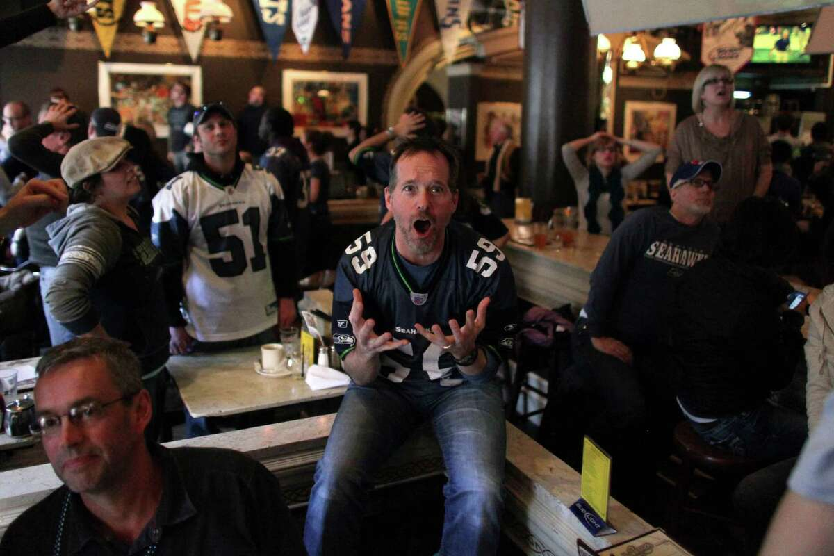 Steve Henry reacts as the Falcons make a field goal in final seconds during a game watching party at FX McRory's sports bar as the Seahawks play the Atlanta Falcons during an NFL playoff game in Atlanta on Sunday, January 13, 2013. The Hawks fell to the Falcons, ending their season.