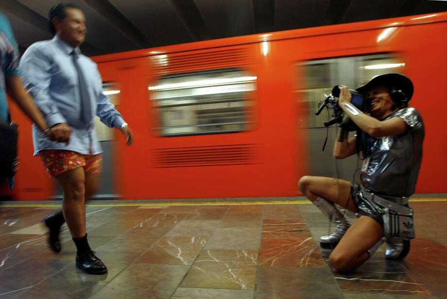 "A man, wearing underwear, records video of another man, also wearing underwear, during the annual ""No Pants Subway Ride"" at a subway station in Mexico City, Sunday. Photo: AP"