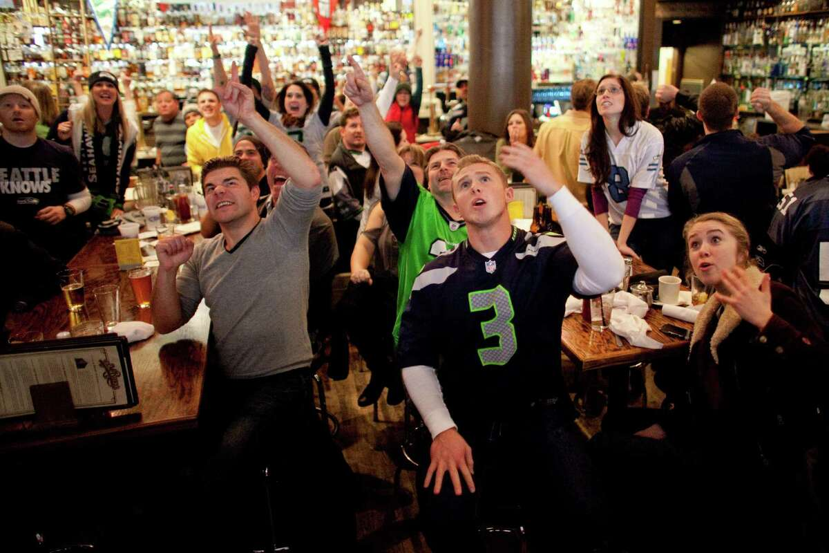Seahawks fans react during a game watching party at FX McRory's sports bar as the Seahawks play the Atlanta Falcons during an NFL playoff game in Atlanta on Sunday, January 13, 2013. The Hawks fell to the Falcons, ending their season.