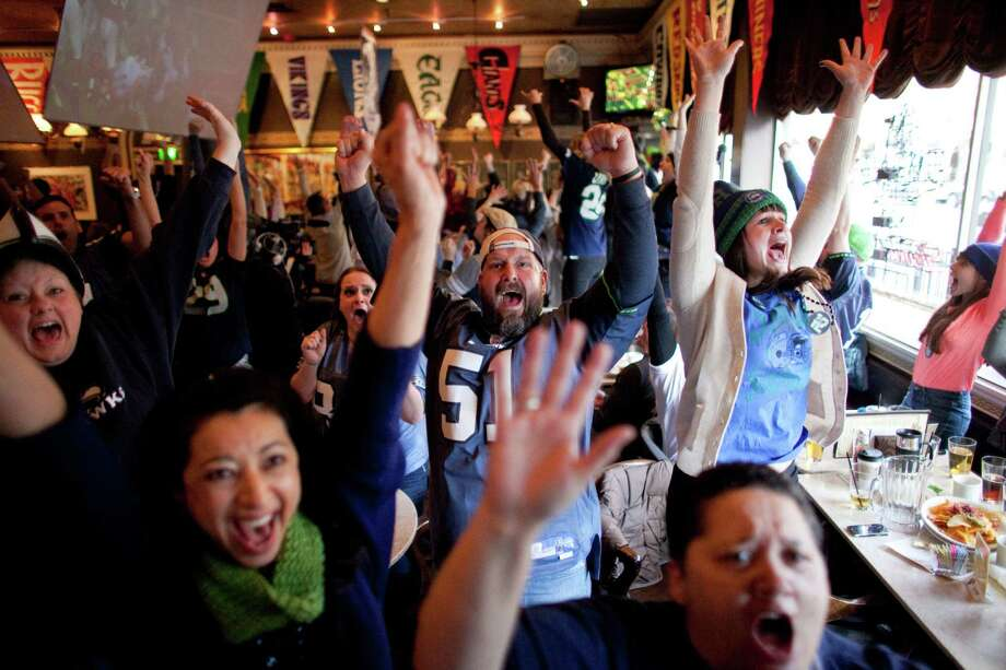 Hawks fans react as the Seahawks score a touchdown in the final minute during a game watching party at FX McRory's sports bar as the Seahawks play the Atlanta Falcons during an NFL playoff game in Atlanta on Sunday, January 13, 2013. The Hawks fell to the Falcons, ending their season. Photo: JOSHUA TRUJILLO, SEATTLEPI.COM / SEATTLEPI.COM