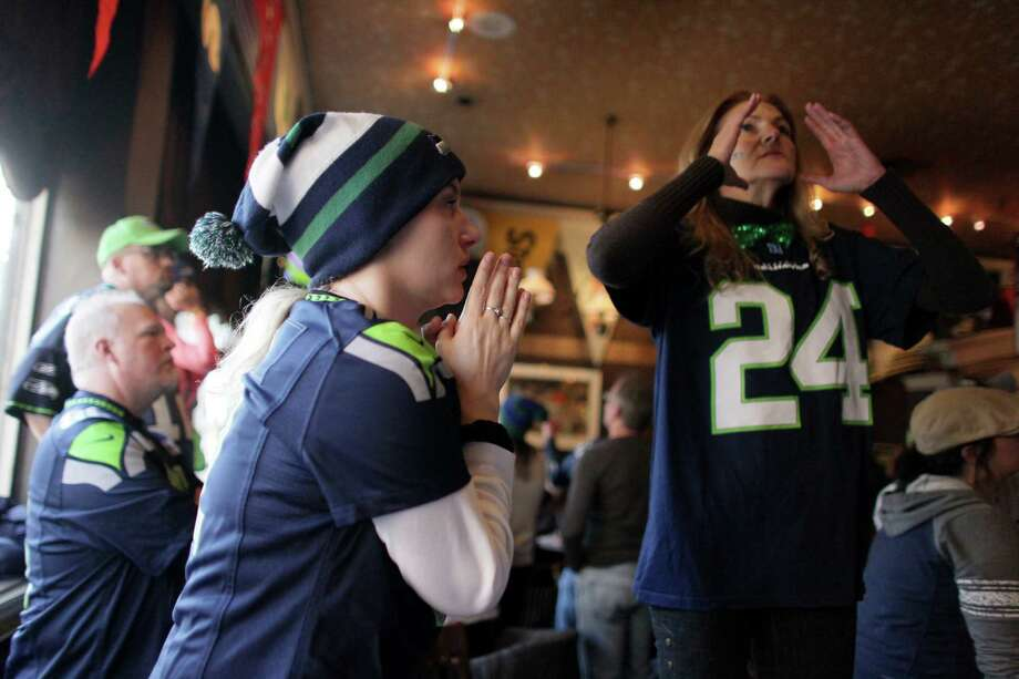Deanne Stewart, left, reacts to the final seconds of the game during a game watching party at FX McRory's sports bar as the Seahawks play the Atlanta Falcons during an NFL playoff game in Atlanta on Sunday, January 13, 2013. The Hawks fell to the Falcons, ending their season. Photo: JOSHUA TRUJILLO, SEATTLEPI.COM / SEATTLEPI.COM