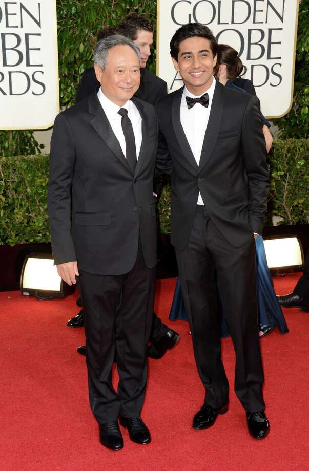 BEVERLY HILLS, CA - JANUARY 13:  Director Ang Lee (L) and actor Suraj Sharma arrive at the 70th Annual Golden Globe Awards held at The Beverly Hilton Hotel on January 13, 2013 in Beverly Hills, California. Photo: Jason Merritt, Getty Images / 2013 Getty Images