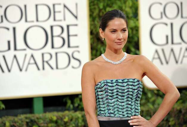 Actress Olivia Munn arrives at the 70th Annual Golden Globe Awards at the Beverly Hilton Hotel on Sunday Jan. 13, 2013, in Beverly Hills, Calif. (Photo by John Shearer/Invision/AP) Photo: John Shearer, Associated Press / Invision