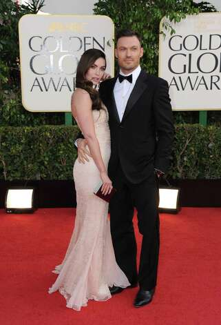 Actors Megan Fox, left, and Brian Austin Green arrive at the 70th Annual Golden Globe Awards at the Beverly Hilton Hotel on Sunday Jan. 13, 2013, in Beverly Hills, Calif. (Photo by Jordan Strauss/Invision/AP) Photo: Jordan Strauss, Associated Press / Invision
