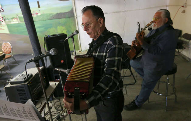 Santiago Jimenez Jr. and bajo sexto musician Margarito Guajardo perform at the restaurant. Photo: Jerry Lara, San Antonio Express-News / © 2013 San Antonio Express-News