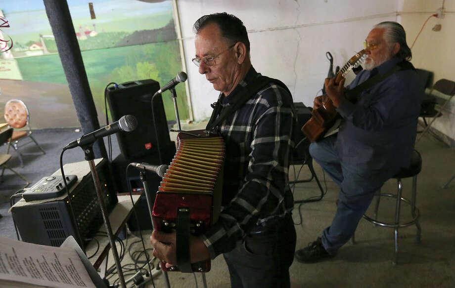 Santiago Jimenez Jr. and bajo sexto musician Margarito Guajardo perform at the restaurant. Photo: Jerry Lara, San Antonio Express-News / © 2013 San Antonio Express-News